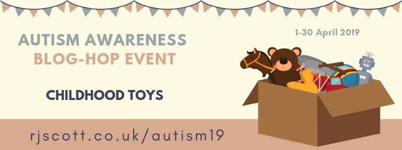 "Banner: Autism Awareness Blog-Hop Event. ""Childhood Toys"" Graphic of cardboard box with toys like teddy bear, hobby horse, etc"