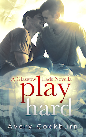 Book cover Play Hard, two young men snuggling on a bed with a tartan green cover